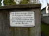 Warning Sign on Cemetery Wall
